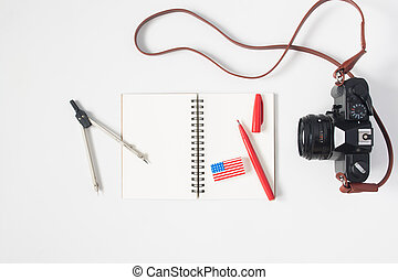 Flat lay of stationery with american flag eraser, notebook...