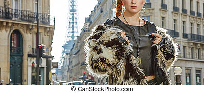 Closeup on modern woman in fur coat in Paris, France -...