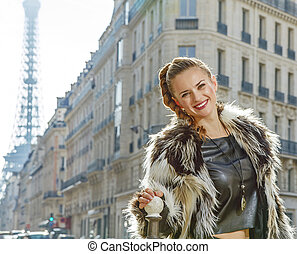 smiling modern woman in fur coat in Paris, France - Boiling...