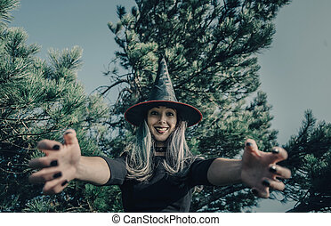 Scary witch in autumn forest - Scary young witch in autumn...