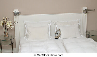 Clock on Pillows - Bed with pillows, bedclothes and alarm...