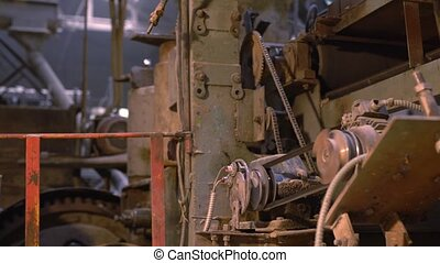 Brickfield. Close-up view of old working machine -...