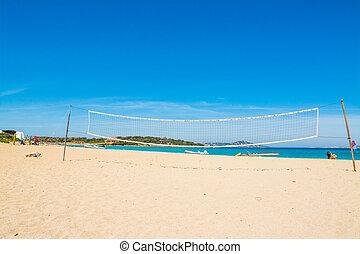 beach volley net and rubber boats in Porto Pollo, Sardinia