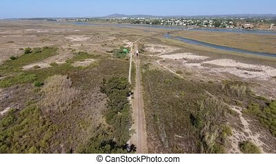 Aerial. Railroad across the Ria Formosa to the beach Barril....
