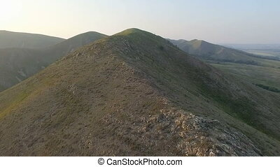 Aerial shot of the summit. - Aerial shot into the mountain,...