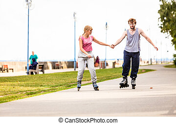 Active young people friends rollerskating outdoor. - Active...