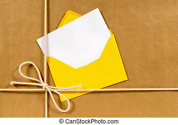 Brown paper parcel with yellow envelope
