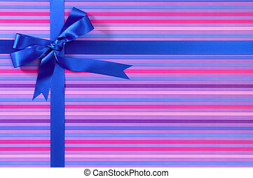 Blue Christmas or birthday gift ribbon bow on candy stripe...