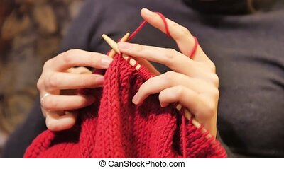 Close-up view of woman hands doing knitting - woman hands...