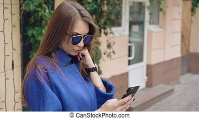 Fashionable lady using and speaking on the phone 4K.