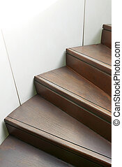 Closeup wooden curve staircase in building