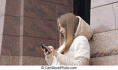 Pretty girl speaking on the phone outdoor