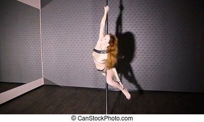 Girl in gold dancing pole dance