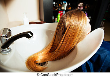 Yuong female making hair care procedure. - Yuong female...