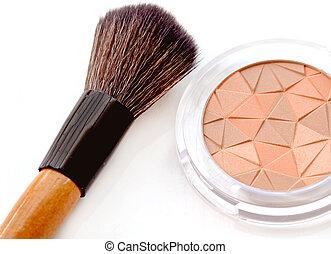 makeup brush with pink blush