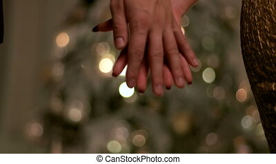 Two young people holding hands on first New year day that they celebrate as a family.