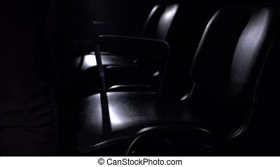 View of conductor sits on chair, close-up - View of...