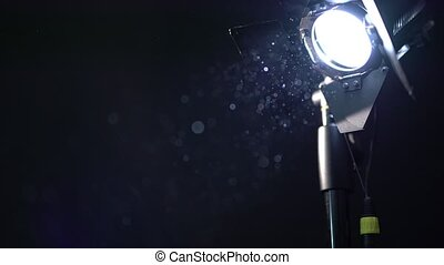 Photo equipment. View of dust in spotlight, close-up