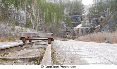 The trolley on the tracks in the quarry. Russia. UltraHD...