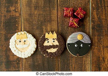 Delicious Christmas cookies a wooden table. Kings mages