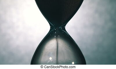 Hourglass on a White Background, the sand Falls Inside