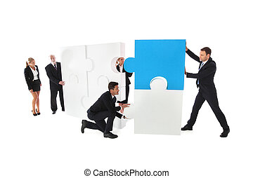 Business teamwork with puzzle - Business teamwork building...