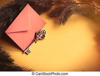Red christmas envelope and vintage key