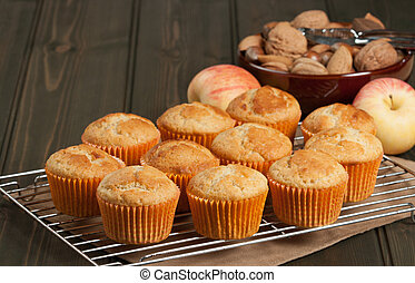 Homebaked Cupcakes In Paper Cases. Wooden Table. Apples....