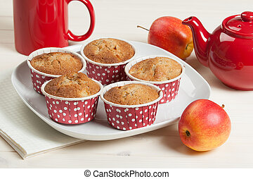 Homebaked Apple Muffins In Paper Cases. Red Teapot. -...