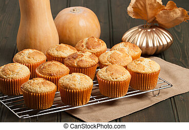 Homebaked Cupcakes In Paper Cases. Wooden Table. Pumpkins....