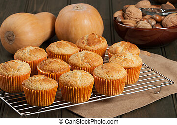 Homebaked Cupcakes In Paper Cases. Wooden Table. Pumpkins. -...