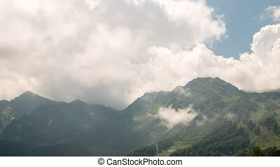 Mountainside in clouds. Panorama. TimeLapse. Rosa Khutor,...