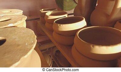 Ceramics before firing on the shelves. UltraHD (4K)