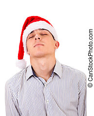 Young Man in Santa Hat Isolated on the White Background