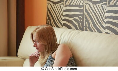 woman on sofa using laptop in living room