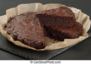 Homebaked Chocolate Brownie In Parchment Paper. Slate Stone....
