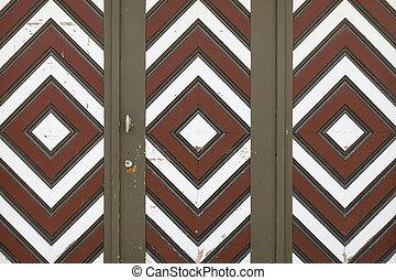 Garage door with brown, white and red diamond pattern - A...