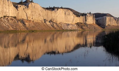 Reflection of the white cliffs of the Missouri River in...