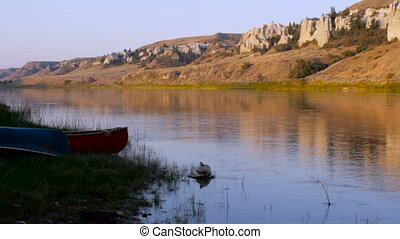Two canoes on the banks of the Missouri River to the white...