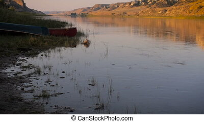 Three canoes along the banks of the Missouri River in...