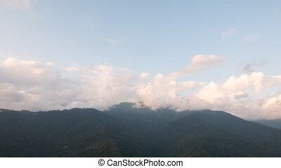 Clouds in the mountains. SunSet. Time Lapse. Sochi, Russia.