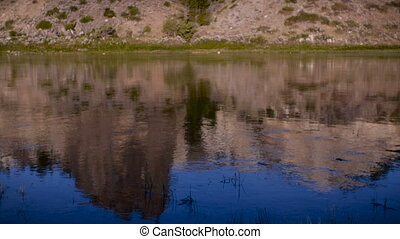 White cliffs reflected in the Missouri River in Montana -...