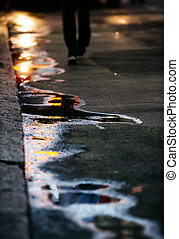 The sun in the puddles. Abstract photography reflection of...