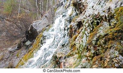 Waterfall in autumn. Russia