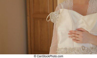 Elegant Bride Trying On Wedding Dress in Bridal Boutique,...