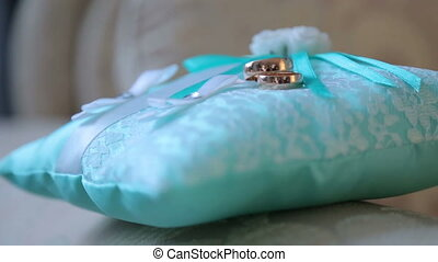 Wedding rings. Wedding rings lying on the pillow. Full HD