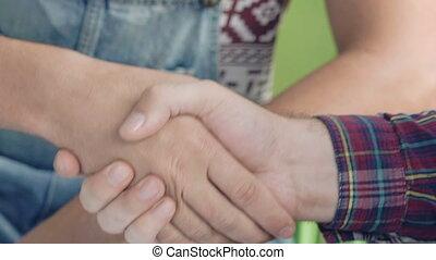 Friendly handshake. Friends handshaking of two hands...