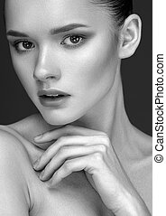 Black and White portrait of Beautiful Young Woman with clean fresh skin