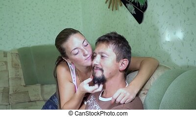 Wife to her husband scratching his beard - Woman gently...