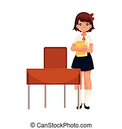 Clever school girl sitting at the desk with open book